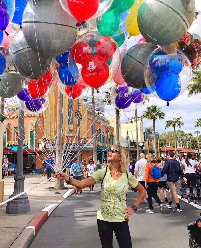 Photo of woman with balloons at Disney World.