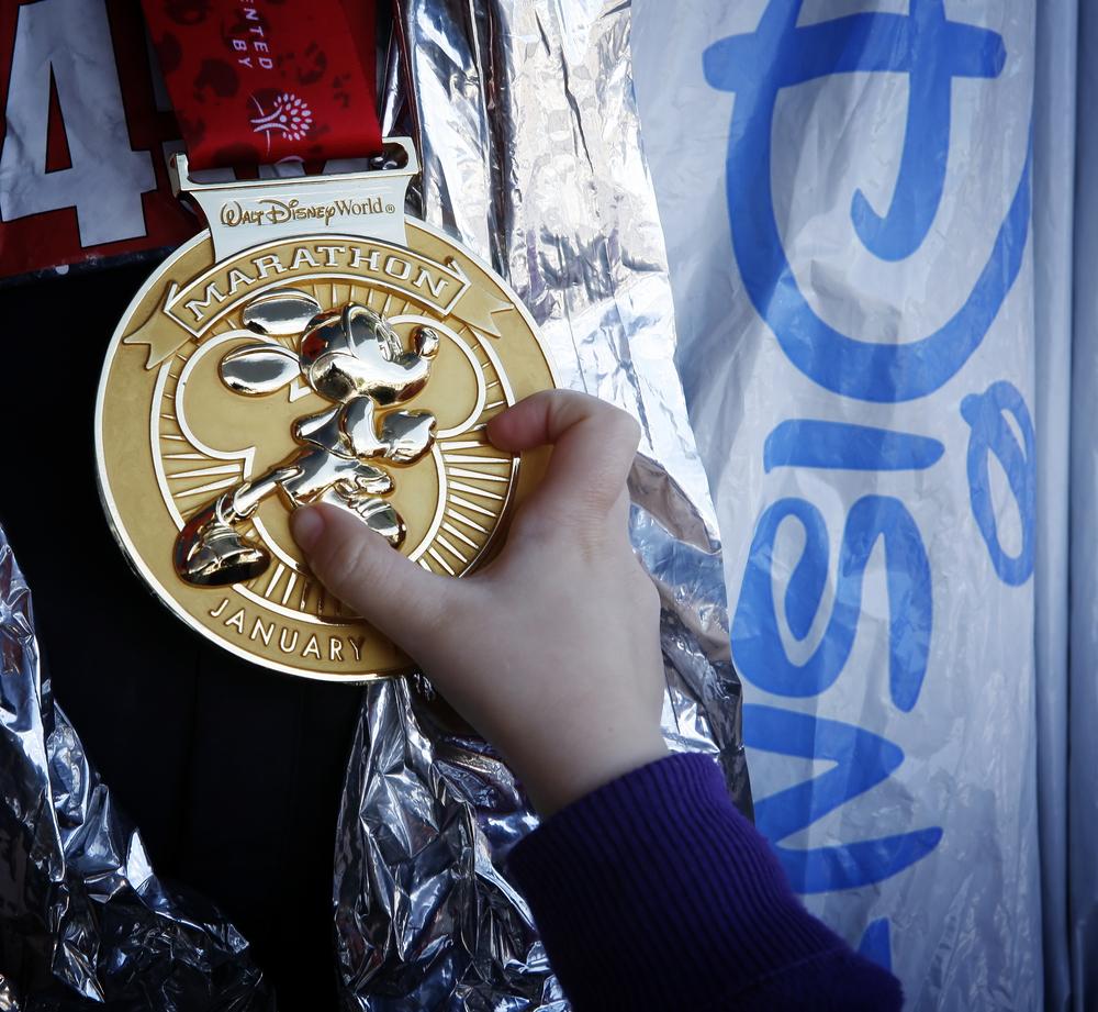 Photo of medal won at race at Disney World.