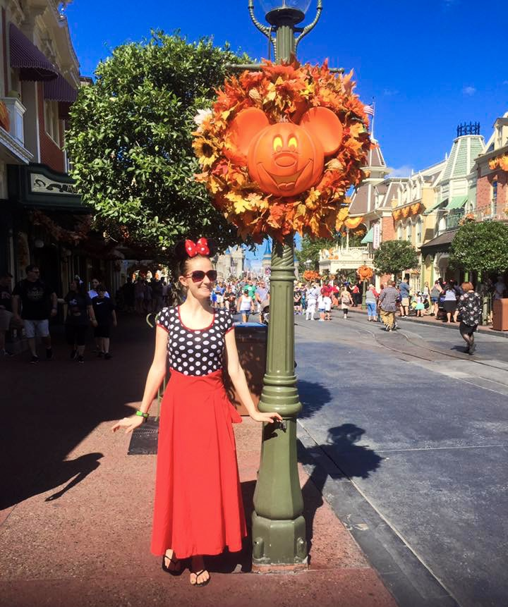 Halloween at Disney on Main street dressed as minnie mouse
