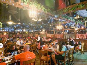Bustling Italian-themed restaurant with twinkling lights