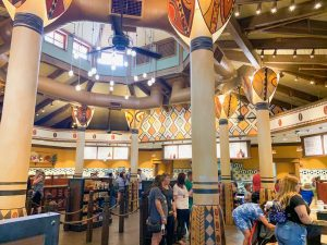 African art-themed indoor ordering area with towering poles