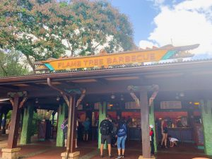 outdoor ordering area with bright orange sign Animal Kingdom restaurants