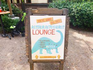 sign for restaurantosaurus with blue dinosaur outline Animal Kingdom restaurants