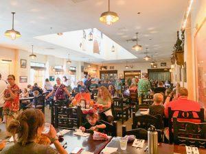 bustling restaurant with black chairs Animal Kingdom restaurants