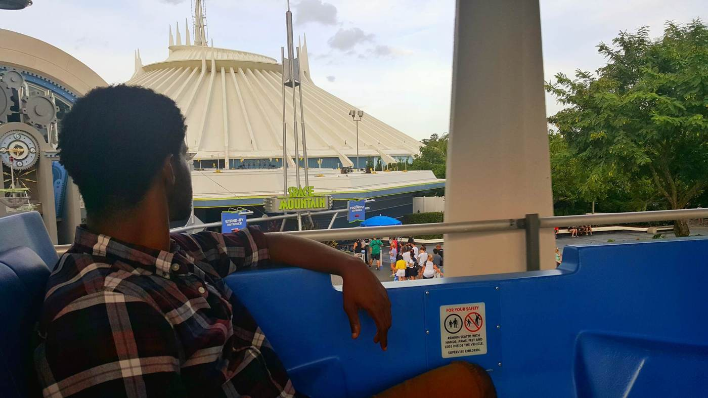 On the Tomorrowland Transit Authority PeopleMover, relaxing as he rides one of the best Magic Kingdom rides.