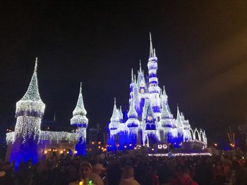 Cinderella Castle decorated in Christmas lights at Disney