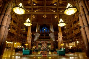 wooden lobby area with extremely high ceiling Disney character dining
