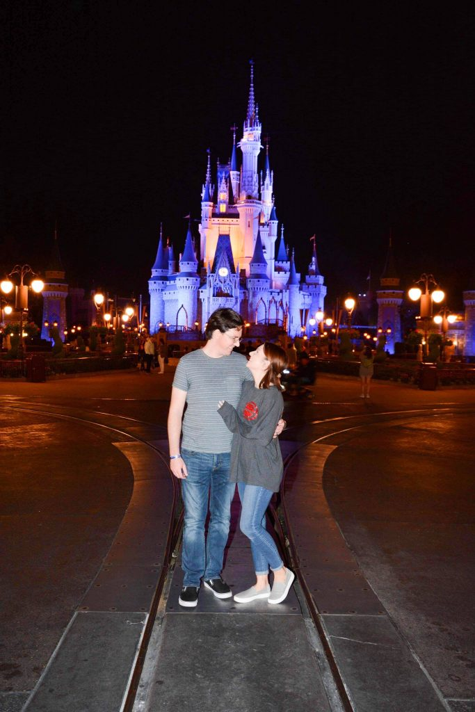 Photo in front of Cinderella's Castle lit up at night