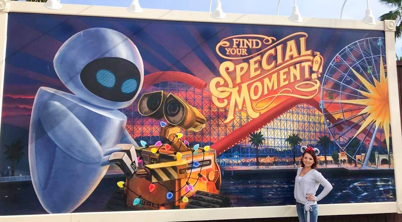 Photo in front of Walle and Eve poster on Boardwalk at Pixar Pier in California Adventure