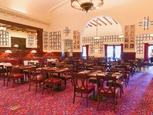 empty dining room with vintage decor and caricatures on the walls
