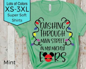 green Christmas-themed Disney shirt with lights