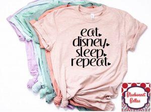 "layered shirts that say ""eat. Disney. sleep. repeat."""