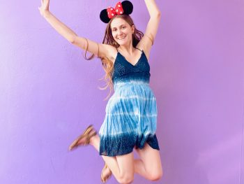 jumping on the purple Disney wall