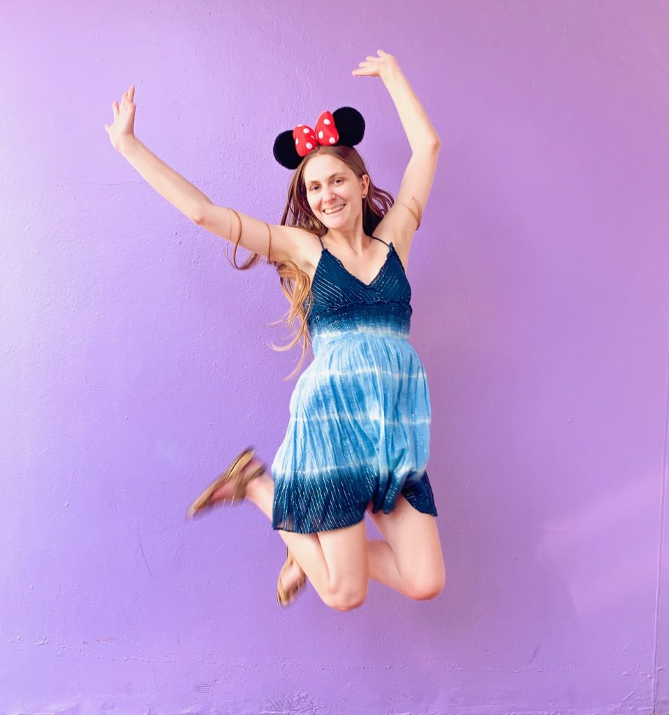 jumping on the purple Disney wall
