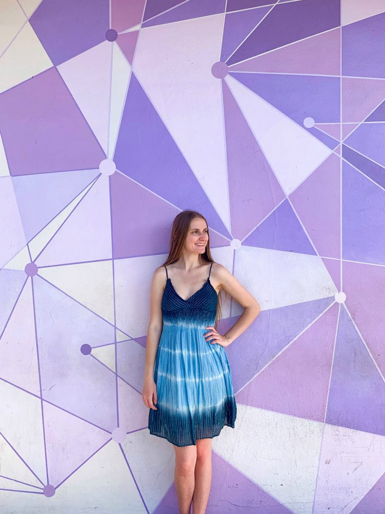 Posing in front of the Galactic Purple wall at Disney's Magic Kingdom