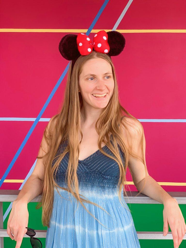 Posing on the Carousel of Progress Disney wall