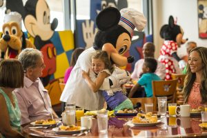Mickey hugging little girl Disney character dining