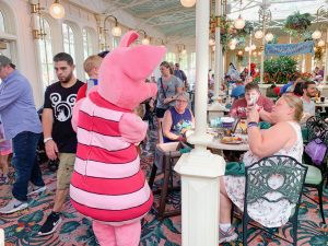 Piglet spending time at a table full of guests Disney character dining