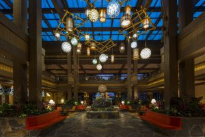 lobby of Disney's Grand Polynesian hotel with various lanterns hanging from the sky Disney character dining