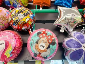 Minnie balloon surrounded by other non-Disney balloons
