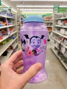 hand holding purple Vampirina reusable water bottle