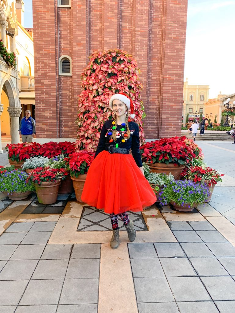 Woman dressed in festive outfit for christmas at disney world