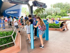 tapping magicband at spaceship earth