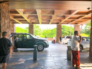 car drop off air with wooden ceiling and lava rock pillars