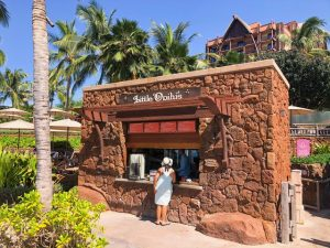 lady ordering at lava rock-built Little Opihi's Disney Aulani Review