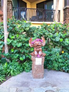 wooden Stitch statue with flower leis Disney Aulani Review