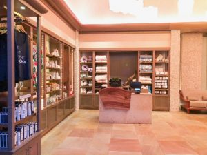 biege spa interior with towels, shampoos, and lotions
