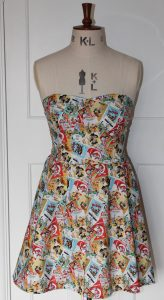 dress covered in a collage of retro Donald duck posters
