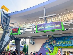 entrance and sign to Buzz Lightyear ride Disney Secrets