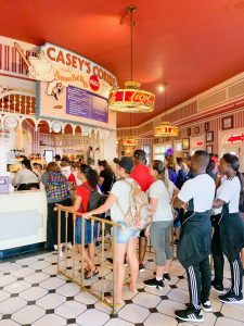 long lines in bright red dining area Disney secrets