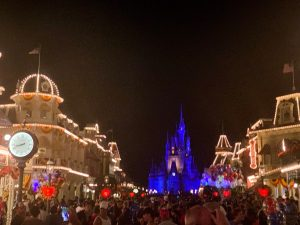 Cinderella's Castle and street in front lit up at night Disney secrets