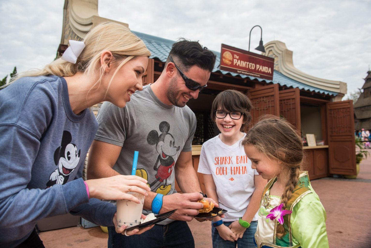 Family enjoying food at Epcot's Festival Of The Arts