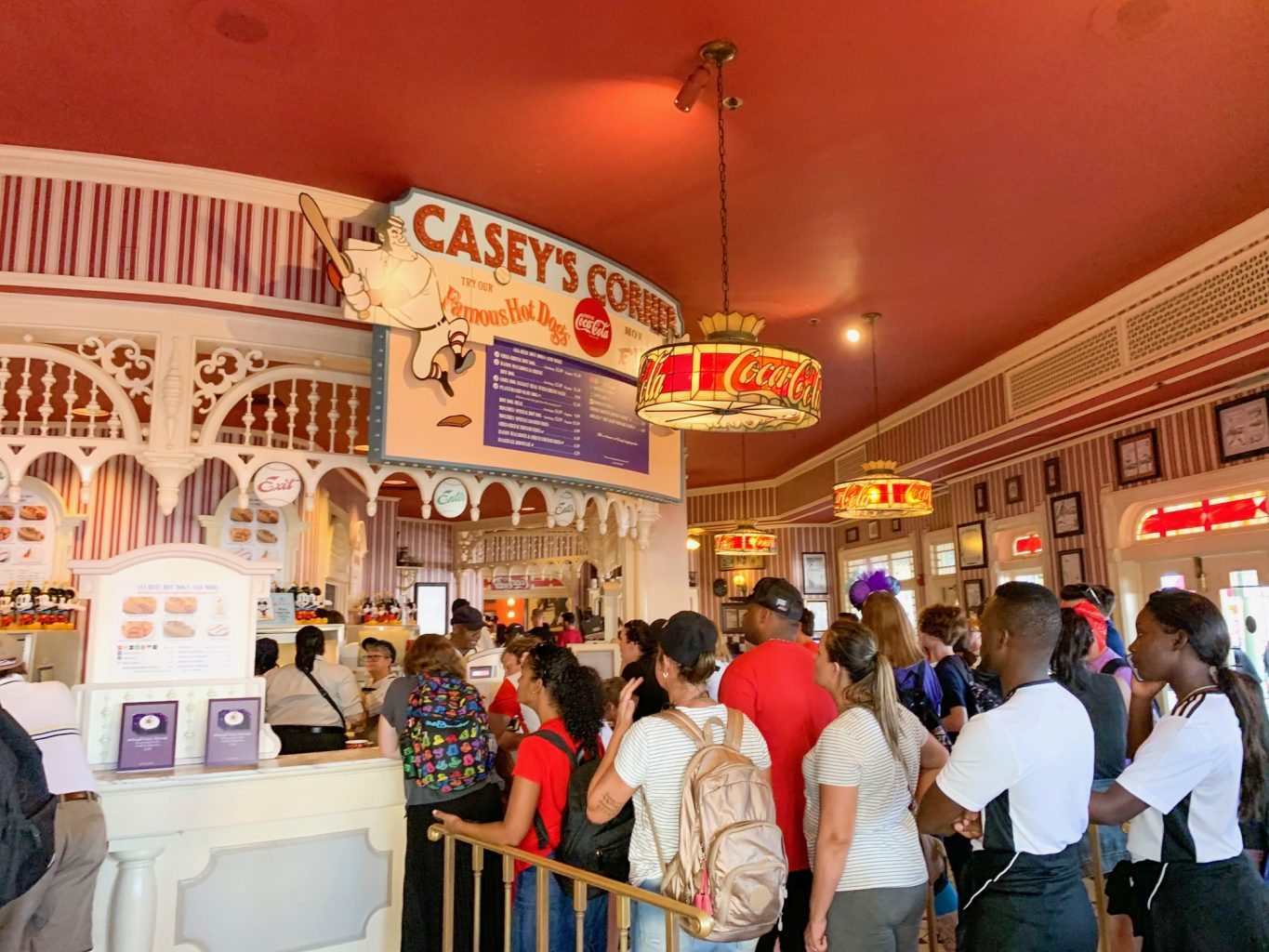 A long queue for one of the most iconic and best Magic Kingdom quick service restaurants, Casey's Corner