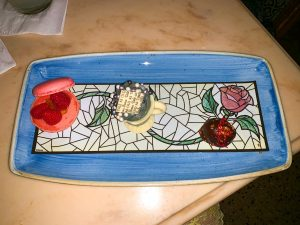 imitation stain glass rose dessert plate with three desserts Magic Kingdom Restaurants