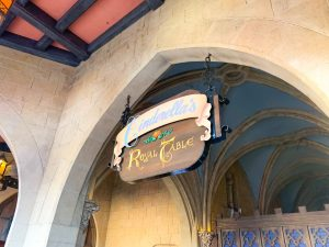 sign for Cinderella's Royal table under stone archway Magic Kingdom restaurants