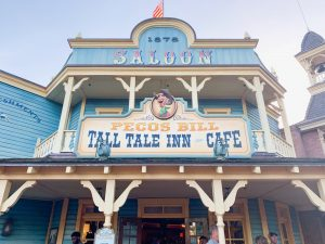 light blue country-style exterior of Pecos Bill Magic Kingdom Restaurants