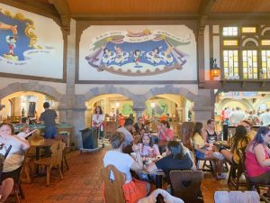 busy dining area with Pinocchio mural