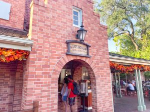 tall brick building with archway and sign Magic Kingdom Restaurants