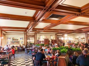 indoor room with wooden beams and outdoor plants Magic Kingdom Restaurants