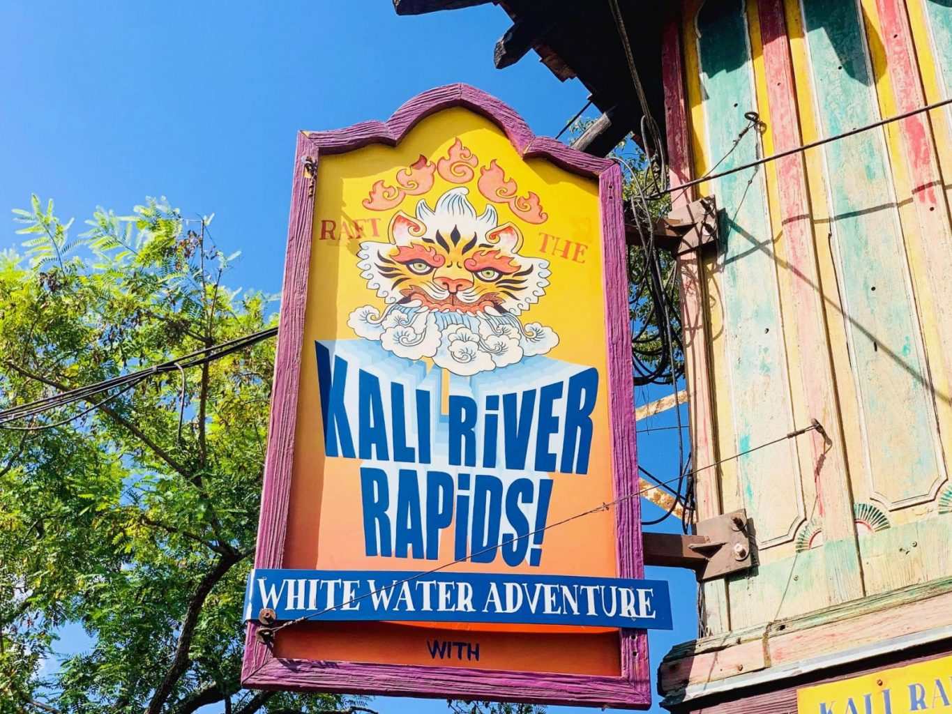 bright yellow, orange, and blue sign with Tiger for Kali River Rapids Animal Kingdom rides