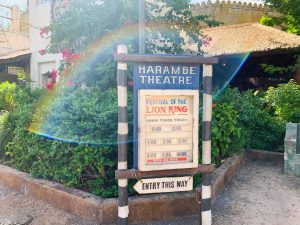 battered sign at Harambe Theater telling showtimes