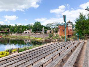 empty wooden benches surrounding lake Animal Kingdom rides