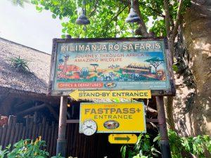 colorful yet old-looking sign for Kilamanjaro Safari