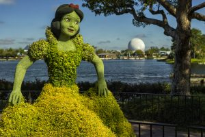 Snow White statue made out of plants with Epcot ball in background