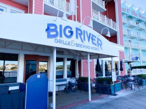 red building with blue and white awning for Big River Disney Boardwalk restaurant