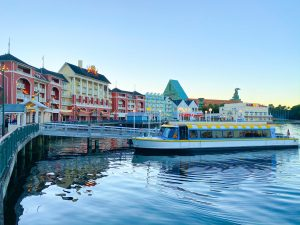 colorful boat in front of colorful buildings on the waterfront